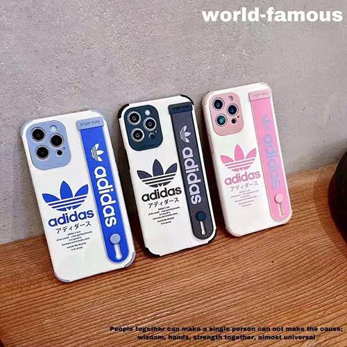 アディダス ブランド iphone13/12 pro max/11 pro max/se2/ 8plusケース ジャケット型 お洒落 iphone 12mini /11pro/xs max/7plusケース ベルト付き アイフォン 12pro /11 /xs/xr/7/8ケース 圓角保護 耐衝撃 ファッション目立つメンズ レディース 人気